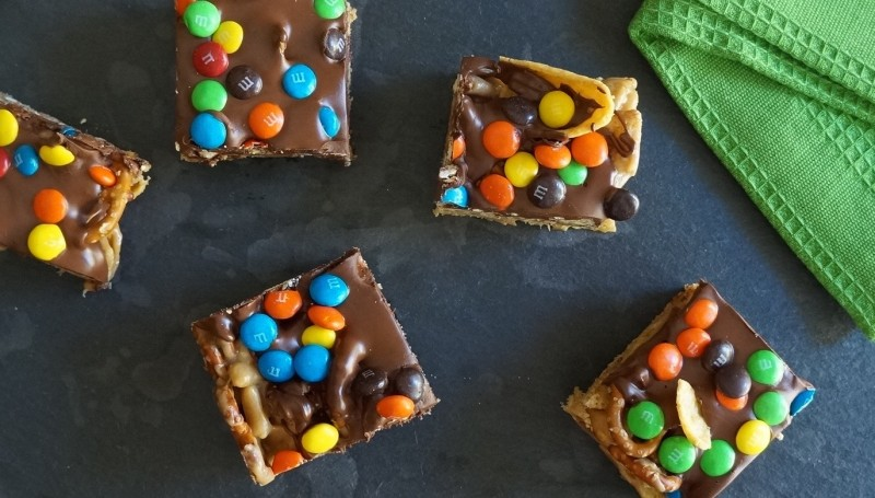 Tailgate Scotcharoos with Peanut Butter Cinnamon Chex M&M's rebeccagordon buttermilklipstick southern recipes Tailgating food ideas party hostess queen